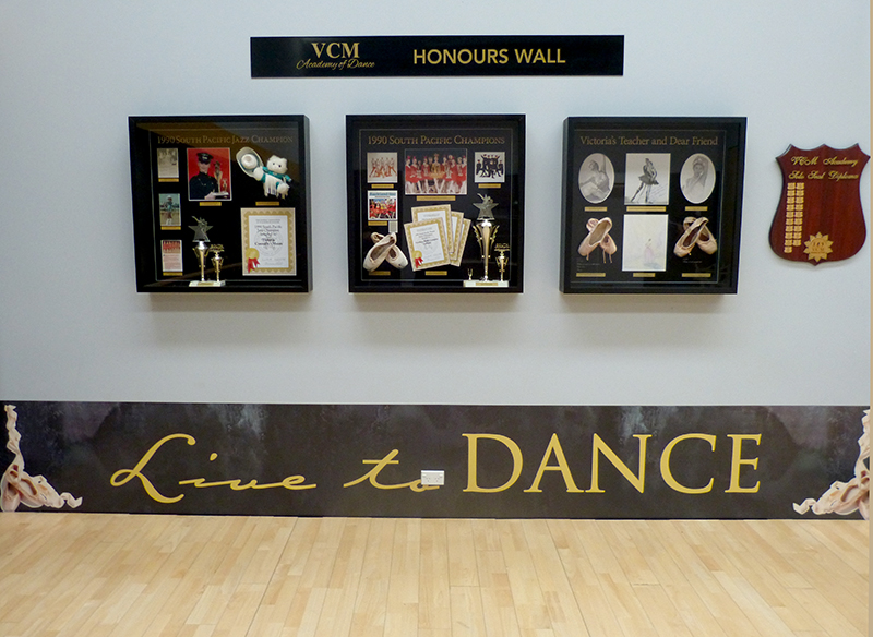 VCM Academy studio interior with dance memorabilia framed on wall