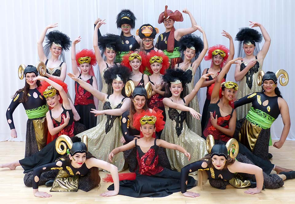 Group photo of VCM Academy students in annual recital costumes