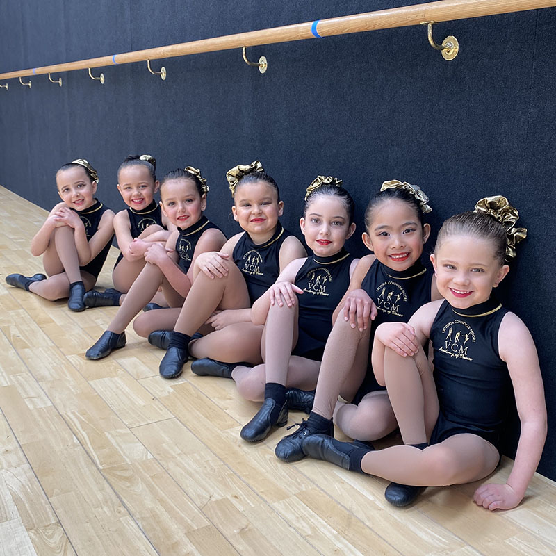 junior jazz dance students sitting together at a leading dance academy